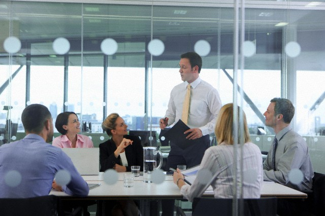 Businessman leading meeting in conference room --- Image by © Ian Lishman/Juice Images/Corbis